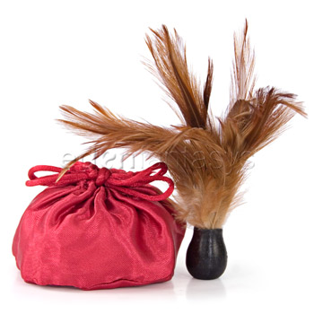 Edible flavored powder in a silky bag with feather applicator